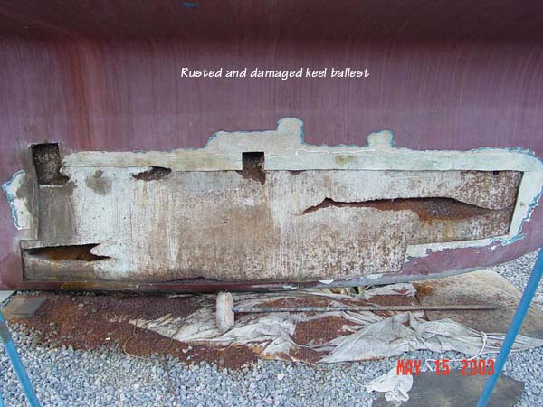 Keel damage – rusted scrap metal added for weight in encapsulated concrete ballast.